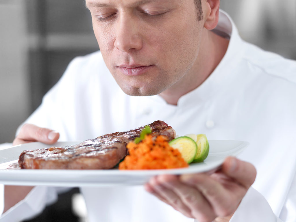 Chef smelling the delicious steak